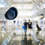 modern-public-cctv-camera-with-blur-interior-shopping-mall-background-copy-space